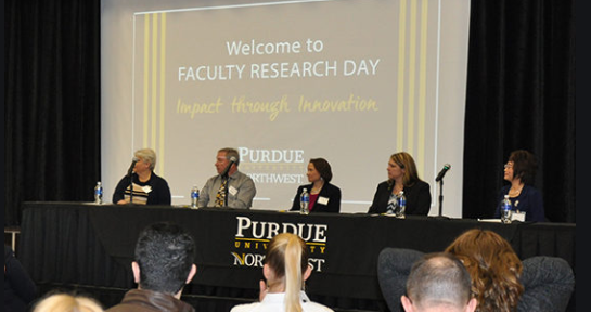 Faculty research panel from 2020 is pictured.