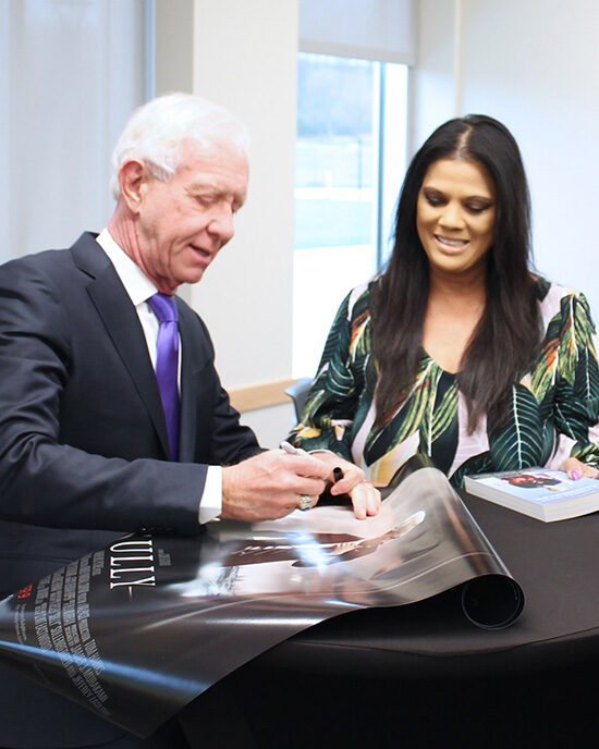 "Captain ""Sully"" Sullenberger signs a poster at Sinai Forum"