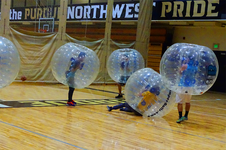 Students play bubble soccer