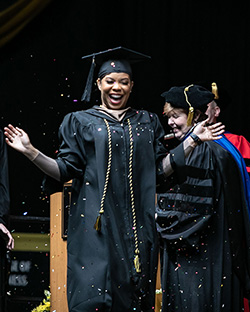 A student celebrates at commencement.