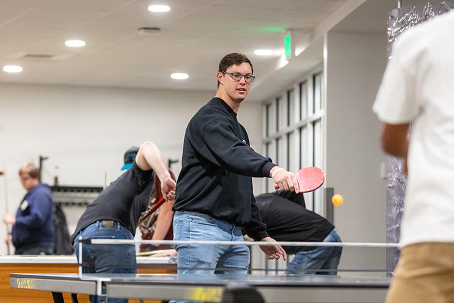 A student plays ping pong in DSAC.