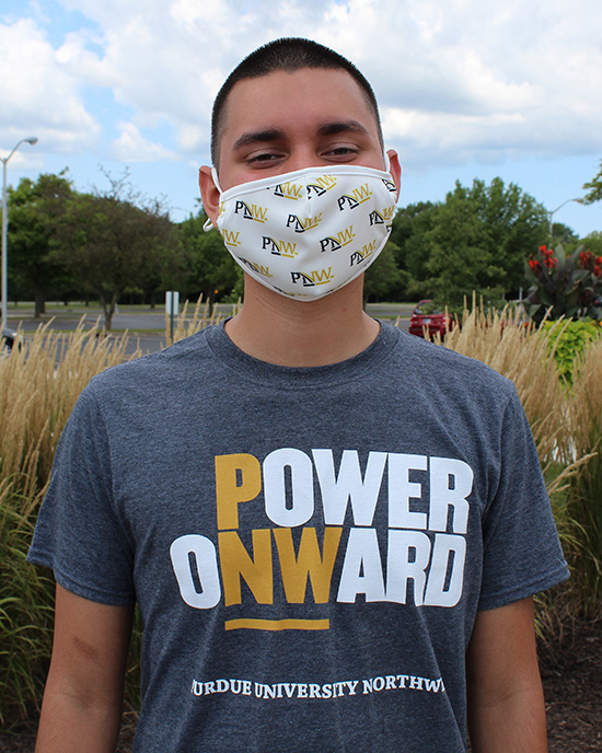 A PNW student wears a mask outdoors