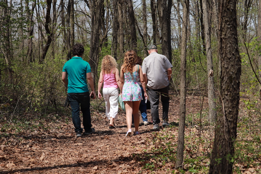 Students walking Gabis Arboretum are pictured.