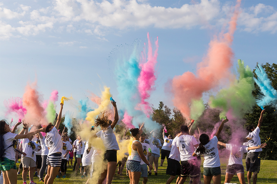 Students kick off the Pride Stride with a spray of color.