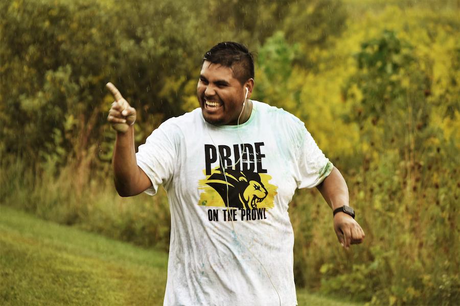 Student running at Pride Stride.