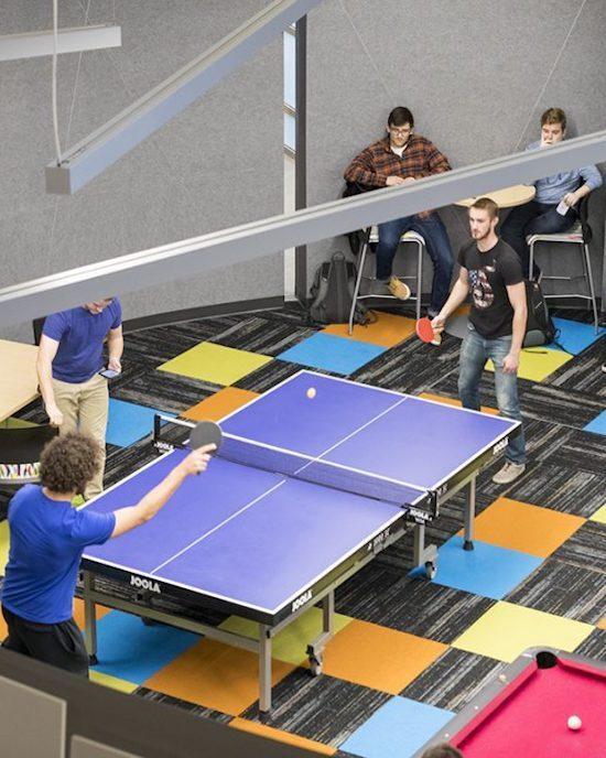 Students playing ping pong.