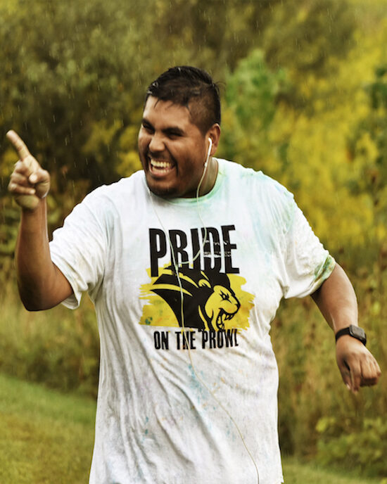 A student running in pride stride is pictured.