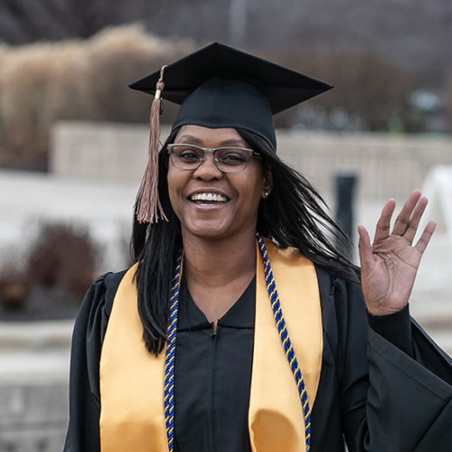 A student waves at PNW's commencement