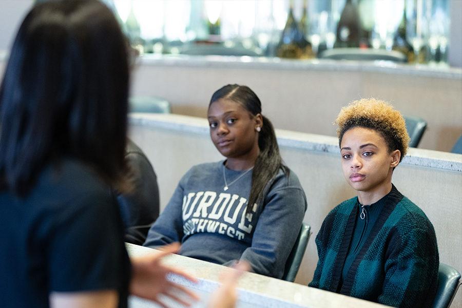 Students looking at a professor