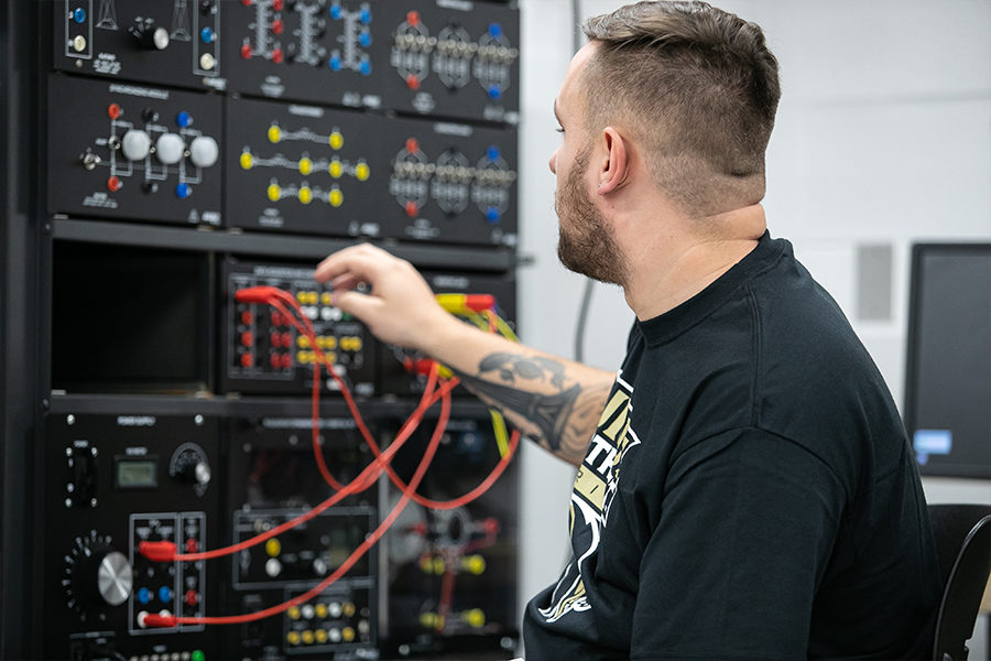 Student working with equipment