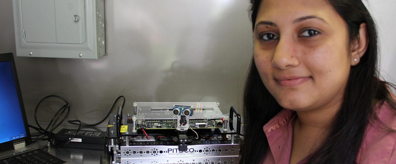 Student presenting autonomus robotic progress