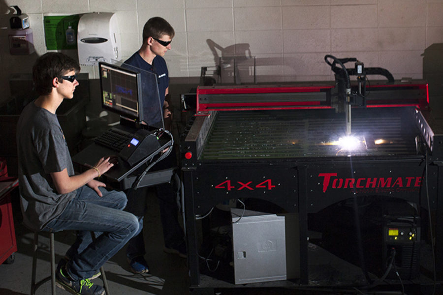 Students prepare pats using a plasma CNC torch