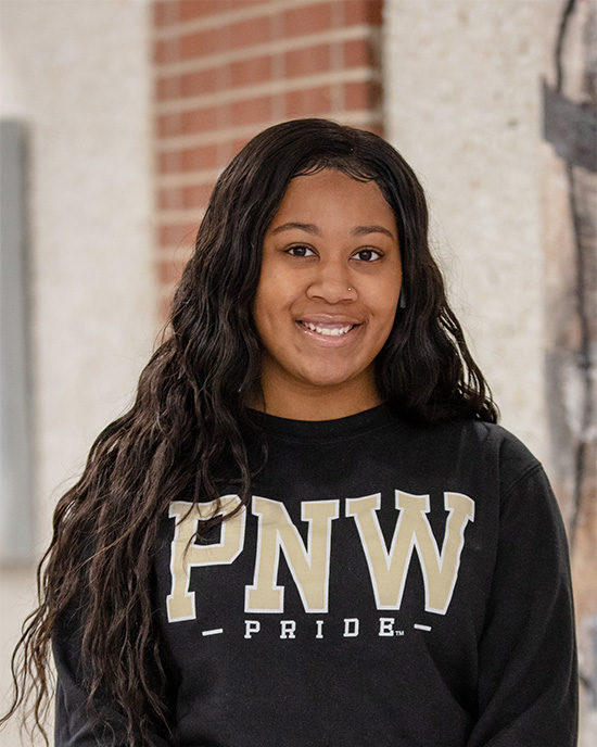 A student wears a PNW pride shirt.