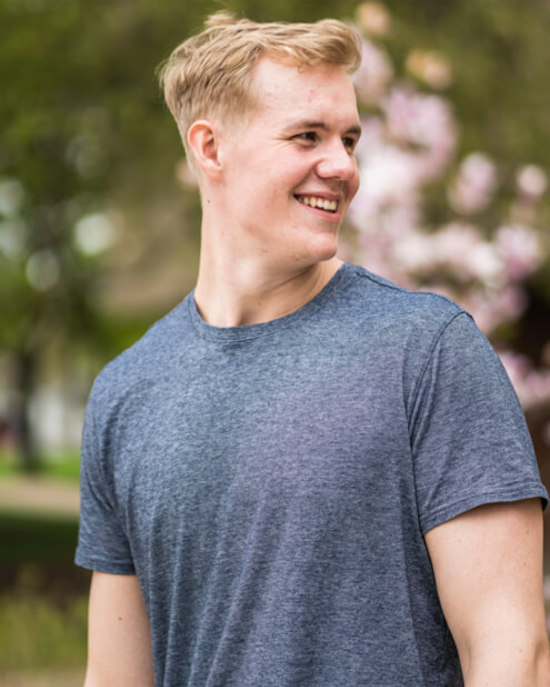 closeup of smiling student in gray shirt