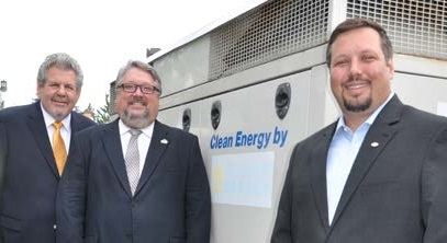 Pictured left to right: Glenn Lubeznik, PNW Dean of the College of Engineering and Sciences Chris Holford and Sam Lubeznik stand next to the cogeneration unit donated to the university