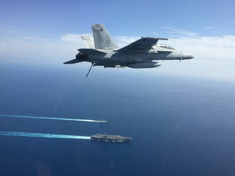 F/A-18 super hornet flown by john tonkovich with aircraft carrier and ship below