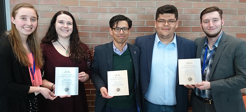 Purdue University Northwest's student steel bridge team accepting their second place awards (pictured left to right): Sara Fisch, Haley Nowakowski, faculty advisor Chien-Chung Chen, Juan Padilla and Santiago Burgos.