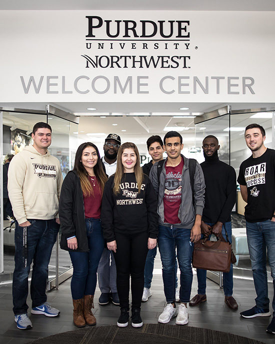 International students stand in front of PNW's Welcome Center