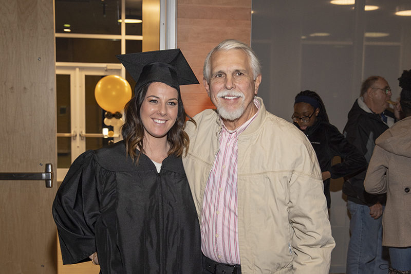 A PNW student celebrates commencement with her father.
