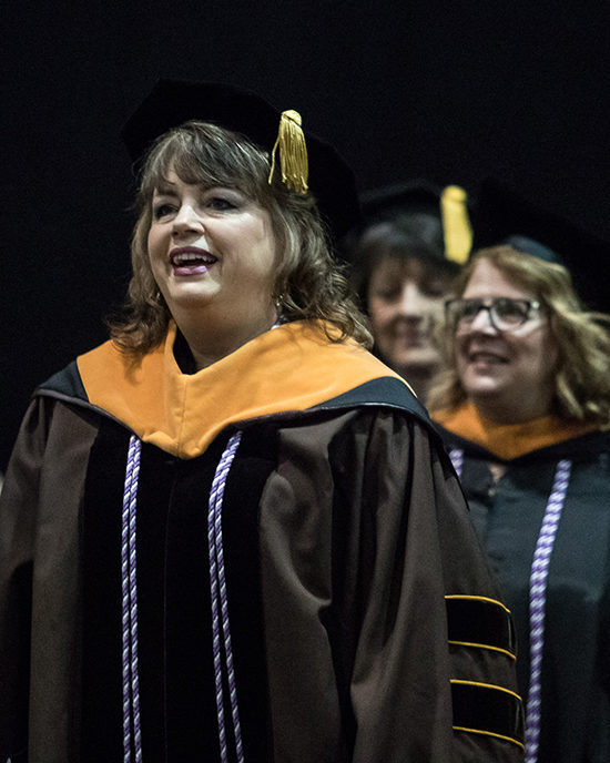 Faculty members march at commencement