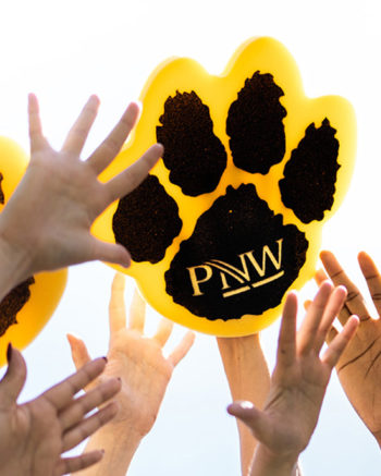 Upraised hands, including a PNW mascot paw.