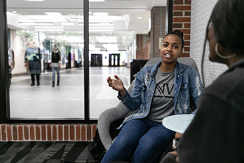 Students talk in a PNW lounge.