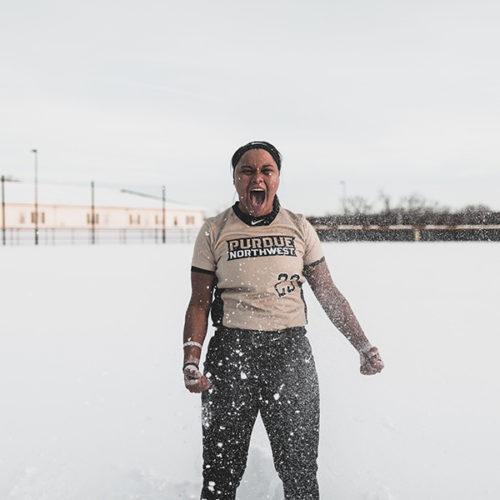 PNW student athlete Kyleigh Payne celebrates in the snow.