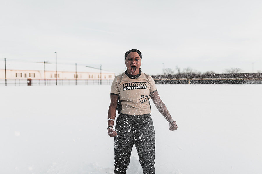 PNW student athlete Kyleigh Payne celebrates in the snow.