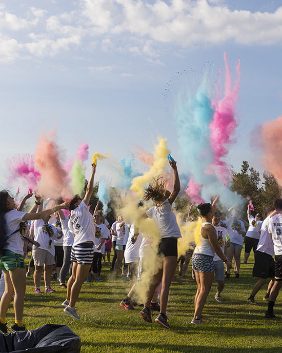 Students throw color to kick off the PNW Pride Stride 5k
