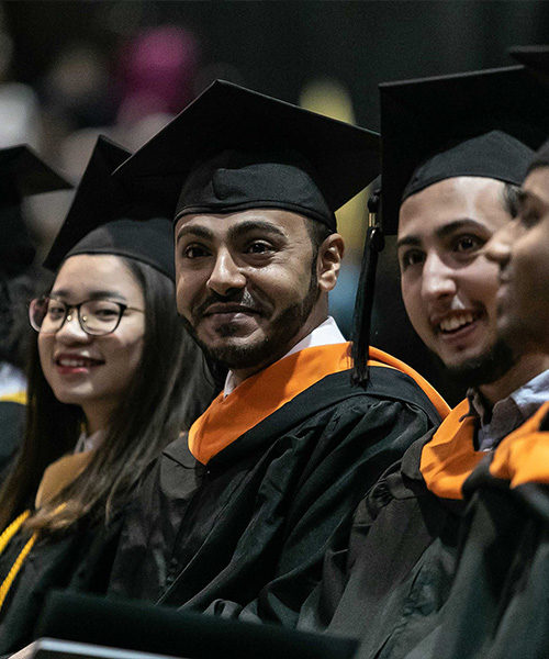 Students anticipate walking across the stage at commencement