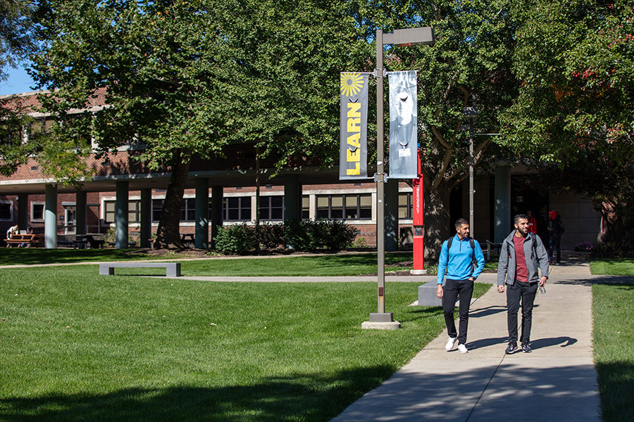 Students walk through founders plaza