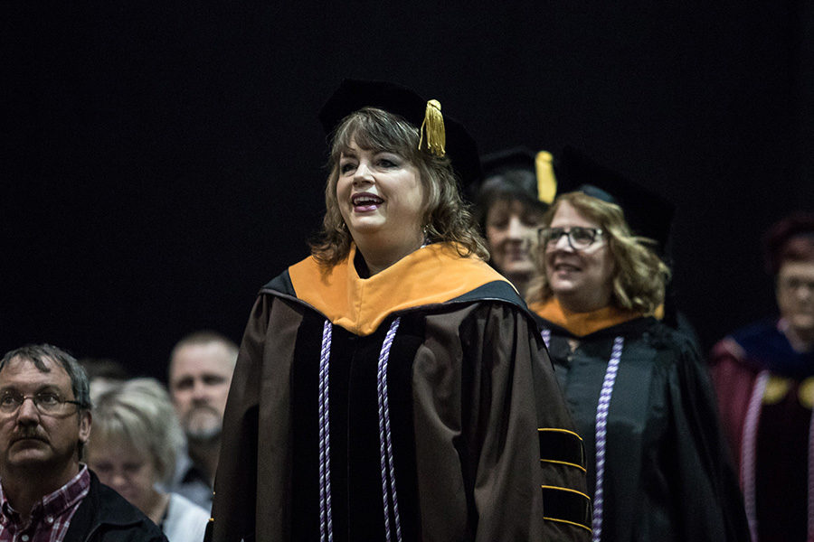 Cheryl Moredich leads PNW faculty in marching at commencement.