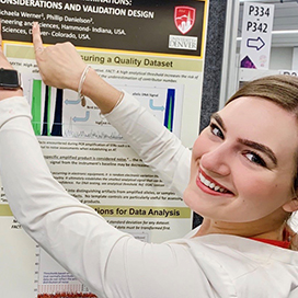 Michaela Werner pointing at research.