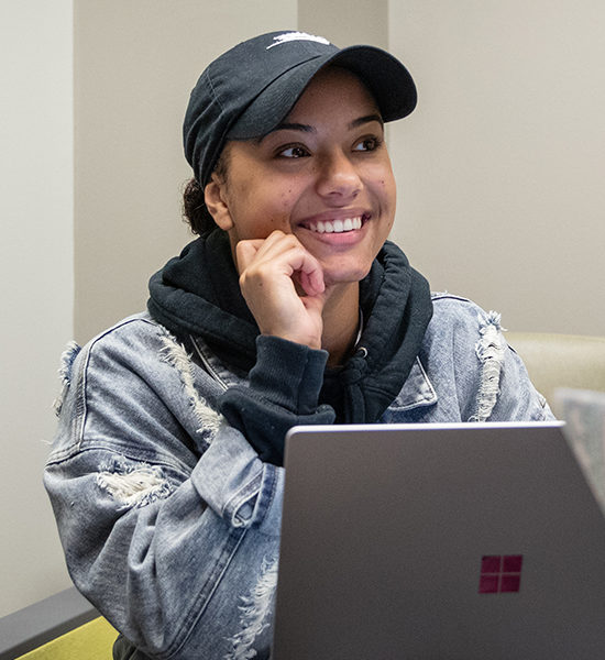 A PNW student studies at her computer