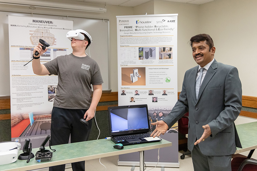 A student and professor in the College of Technology are pictured.