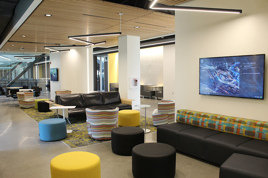 Stools and screens in the Nils K Nelson Bioscience Innovation Building's lobby.