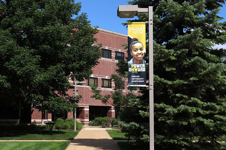 """A walkway on PNW's Hammond Campus with a """"Power Onward"""" banner."""