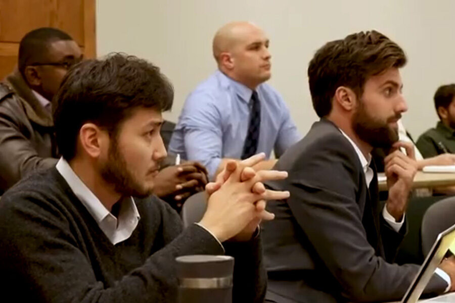 Executive MBA students listen in the classroom