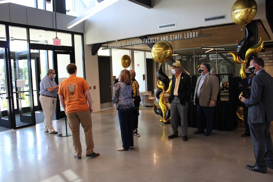 Gathering for ribbon cutting is pictured.