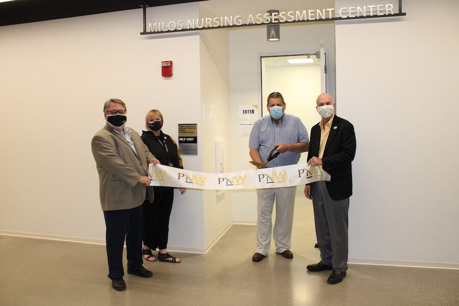 Ribbon cutting is pictured.