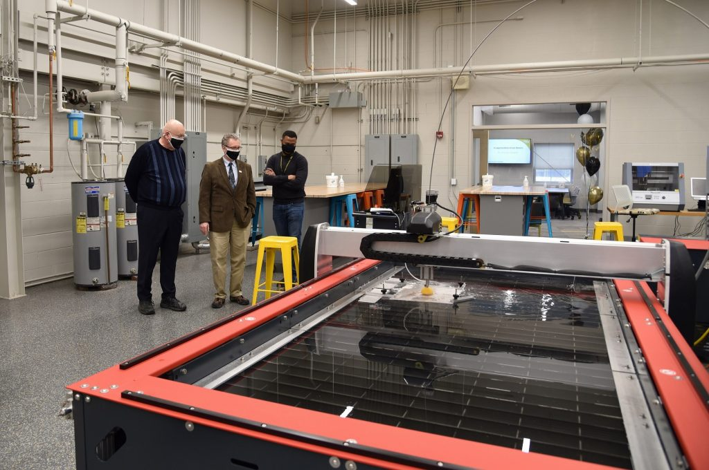 Stewart McMillan, chairman emeritus of Task Force Tips, tours the new PNW Design Studio with Dietmar Rempfer, director of the PNW School of Engineering and Marcel Mejulu, Design Studio support technician.