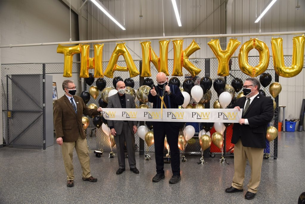 (From left): Dietmar Rempfer, director of the Purdue University Northwest (PNW) School of Engineering; PNW Chancellor Thomas L. Keon; Stewart McMillan, chairman emeritus of Task Force Tips; and Kenneth C. Holford, PNW provost and vice chancellor for Academic Affairs, cut the ribbon on the PNW Design Studio.