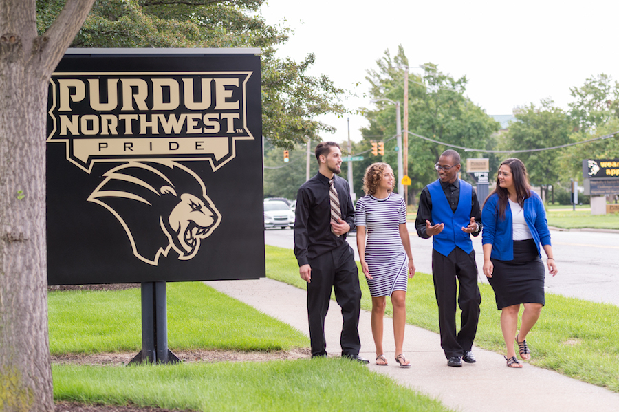 Students are pictured at the entrance to campus.