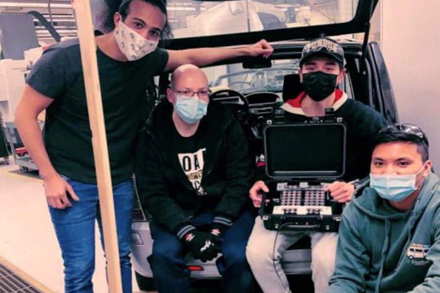 PNW students pose with their electric-vehicle battery.