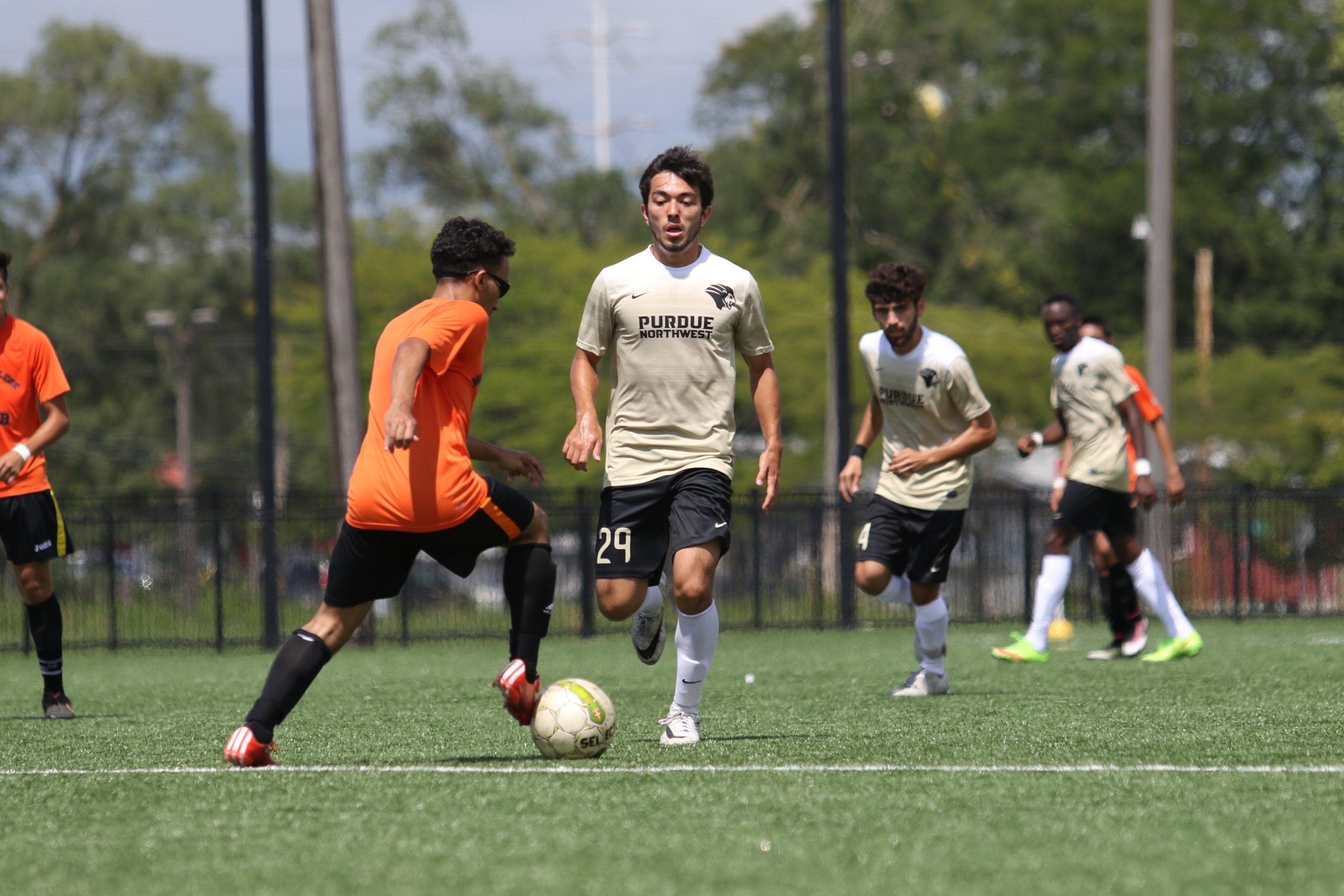 A PNW soccer player advances the ball up the field
