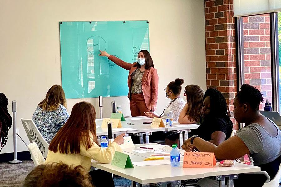 A professor speaks in a classroom