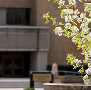 Flowers bloom in front of the Technology building on PNW's Westville campus