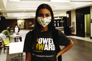 A PNW student in a mask and a Power Onward t-shirt