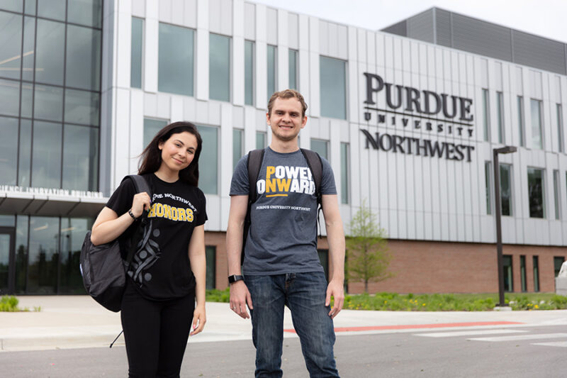 Current PNW students pose in front of the Nils K. Nelson Bioscience Innovation Building.