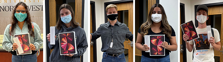 Winners of the PNW Roaring Ahead Scavenger Hunt pose with their prize. From left to right: Arti Patel, Boba Cucuz, Jake Dyrkacz, Julia Villalpando and Stephen Kamps